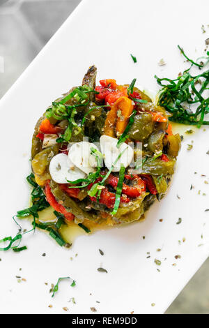 portuguese roast organic bell peppers and garlic mediterranean tapas salad in lisbon restaurant - Stock Image