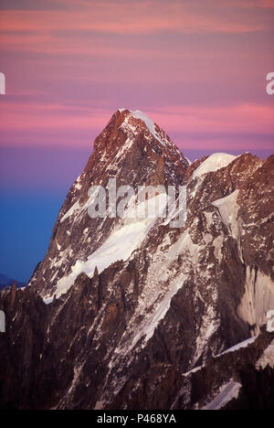 Sunset on the mighty Grandes Jorasses in the French Alps - Stock Image