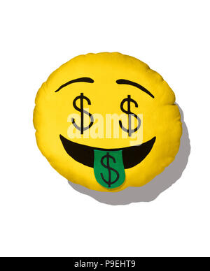 A colourful shot of the dollar sign Emoji cushion. - Stock Image