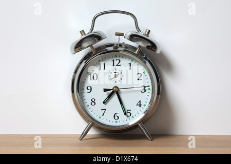 Old style chrome alarm clock with two bells. - Stock Image