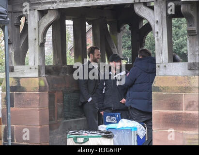 Great Budworth, UK. 11th April, 2018. Actor Rafe Spall with director Craig Viveiros waiting between takes in the church gate in the new BBC drama 'War - Stock Image