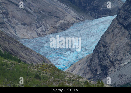 Nigardsbreeen, Norway - 7 August 2018: Tourist see on on an excursion of the arm of the Nigardsbreeen Glacier. The glacier highy eroded by the hot 2018 summer  is about an hours drive from Skjolden. Photo: David Mbiyu - Stock Image
