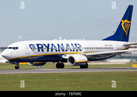Ryanair Boeing 737-800, registration EI-AKH, preparing for take off at Manchester Airport, England. - Stock Image