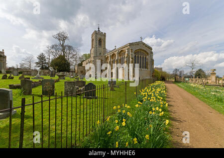 The church of St Mary Magdalene in the grounds of Castle Ashby House, Northamptonshire, UK; mainly 14th and 15th century but restored in 1869. - Stock Image