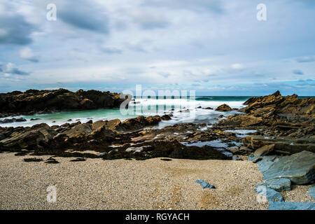 Long exposure of waves and surf at Fistral Beach, Newquay, Cornwall, UK - Stock Image