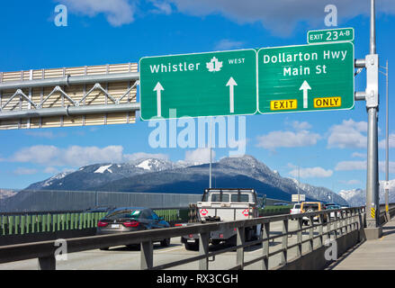 Ironworkers Memorial Bridge (Second Narrows Bridge) in Vancouver, BC, Canada. Vehicles travelling northbound on Highway 1 over to North Vancouver. - Stock Image