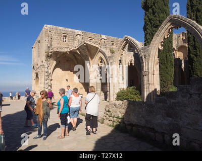 Bellapais Abbey a tourist attraction in Northern Cyprus with gothic ruins, a beautiful orthodox church and coastal views - Stock Image