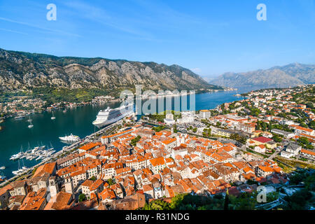View of the cruise port and medieval coastal city of Kotor, Montenegro, from the hillside ruins of the castle of San Giovanni. - Stock Image
