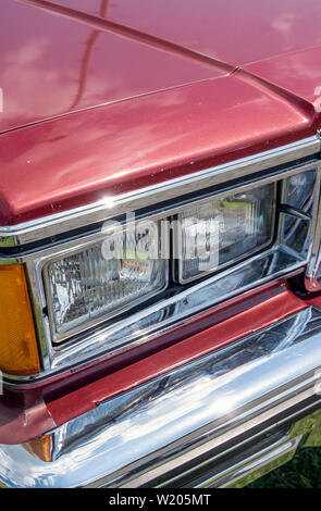 Headlights of a red vintage Lincoln Continental car - Stock Image