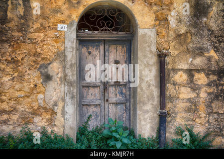 No.30, Agrigento, Sicily. Great colours and textures, these old entrances are beautiful. - Stock Image