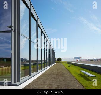 View along glass facade towrads Würth premises. Carmen Würth Forum, Künzelsau-Gaisbach, Germany. - Stock Image