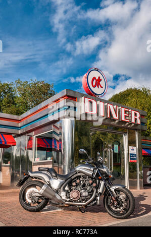 Leominster, Herefordshire, UK. A Yamaha VMAX motorcycle outside the 1950's American themed OK Diner on the main A49 road - Stock Image