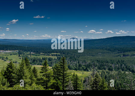 View from vista point of CA 299 East near Burney, featuring pine trees and mountains in the valley below, this view is typical of the cascades in Nort - Stock Image