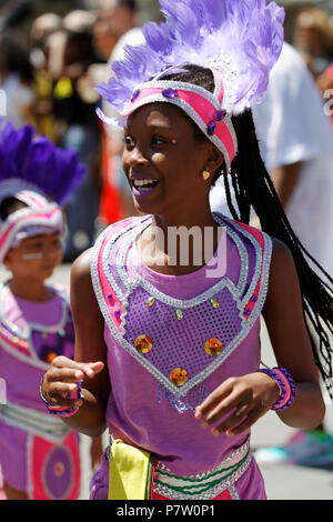 Montreal, Canada. 7/7/2018. A young participant in the   Carifiesta parade in downtown Montreal. Credit: richard prudhomme/Alamy Live News - Stock Image