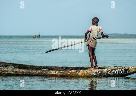 Boy in dugout canoe, Sei Island, the Turtle Islands, Sierra Leone. - Stock Image