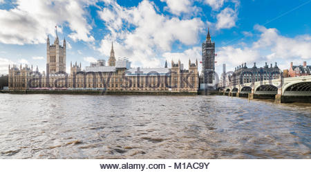 The Palace of Westminster (House of the UK parliament)accross the River Thames undergoing renovation works in January - Stock Image