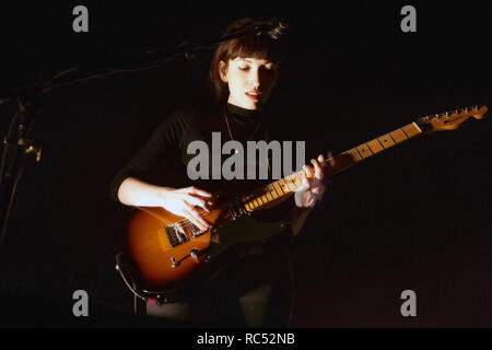 Elena Tonra of Daughter and Ex:Re playing a Fender Telecaster electric guitar during a live performance. - Stock Image