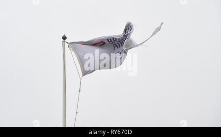 Brighton, UK. 12th Mar, 2019. The British Airways i360 tower flag gets blown apart as Storm Gareth arrives in Britain and Ireland with wind speeds forecast to reach up to 70 mph in some areas Credit: Simon Dack/Alamy Live News - Stock Image