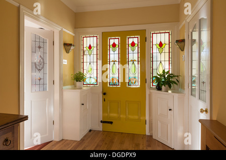 Front door and hallway of domestic house - Stock Image