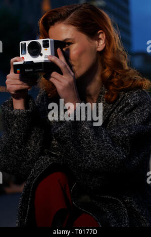 Quebec,Canada. A model taking a picture with a Polaroid OneStep 2 camera - Stock Image