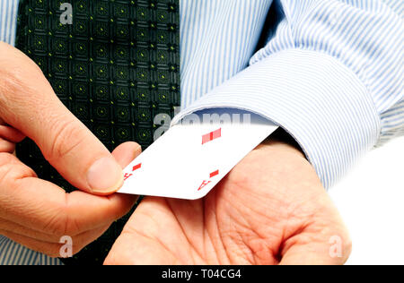 man in shirt and tie showing an ace out from his sleeve, idiomatic expression for: ace up your sleeve - Stock Image