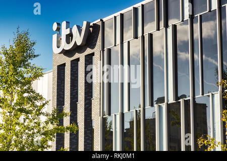 2 November 2018: Salford Quays, Manchester, UK - ITV building with logo, beautiful autumn day with clear blue sky, bright foliage. - Stock Image