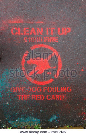 Clean it up Give Dog Fouling the Red Card campaign in Abergavenny, Monmouthshire, Wales, UK with red stencilled sign on pavement, to deter dog fouling - Stock Image