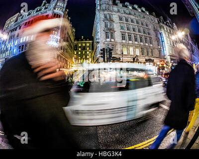 Candid photo, long exposure, taken on the Strand London with Fish eye lens - Stock Image