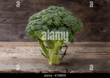 broccoli on a wooden background closeup - Stock Image