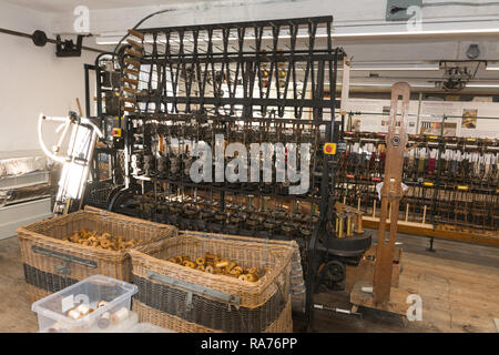 Whitchurch Silk Mill in Hampshire, UK. Interior of the industrial heritage museum with Victorian machinery. - Stock Image