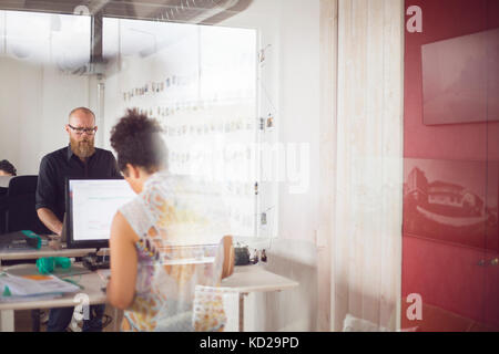 Man and woman working in office - Stock Image