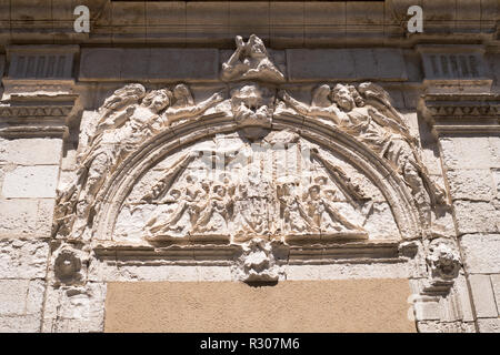 Stone relief carving above the old entrance to the 17th century chapel of the Ursuline convent, Auxerre, Burgundy, France, Europe - Stock Image