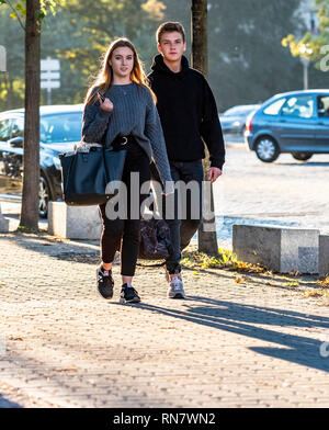 Strasbourg, Alsace, France, young couple walking on pavement, - Stock Image
