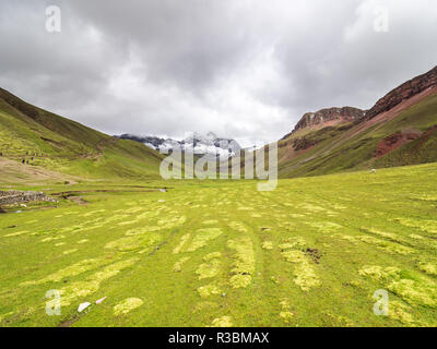 View of a valley near the Vinicunca mountain - Stock Image