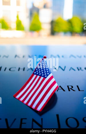 The names of some of the victims marked by the American flag on the 9/11 World Trade Centre Memorial fountains in Lower Manhattan, New York City - Stock Image