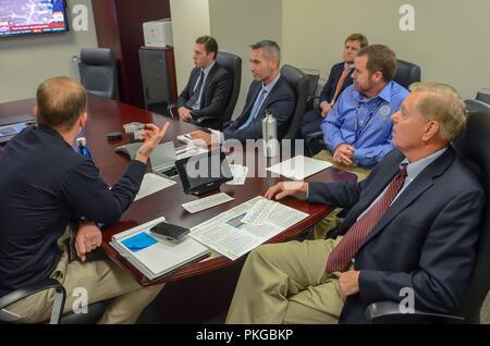 FEMA Administrator Brock Long, left, briefs U.S. Sen. Lindsey Graham of South Carolina to discuss the efforts of FEMA and federal partners in support of Hurricane Florence at the National Response Coordination Center September 13, 2018 in Washington, DC. - Stock Image