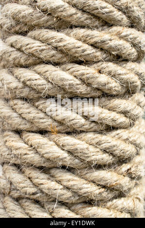 Close up of part of a rope wrapped around a post - Stock Image