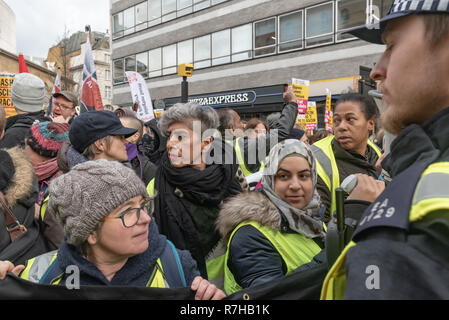London, UK. 9th Dec, 2018. Protesters line up close to the BBC for the united counter demonstration by anti-fascists marches in opposition to Tommy Robinson's fascist pro-Brexit march. Nita Sanghera - UCU at centre. The march which included both remain and leave supporting anti-fascists gathered at the BBC to to to a rally at Downing St. Police had issued conditions on both events designed to keep the two groups well apart. Credit: Peter Marshall/Alamy Live News - Stock Image