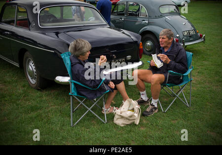 Essex, UK. 12th August 2018. Saffron Walden Motor Show 12 August 2018 Lunch being taken by those exhibiting their classic and vintage cars. More than 500 classic and vintage cars, motor bikes were on display at the annual Saffron Walden Motor Show on Saffron walden common. Money raised goes to the Arthur Rank Hospice and Riding for the disabled in nearby Radwinter. Credit: BRIAN HARRIS/Alamy Live News - Stock Image