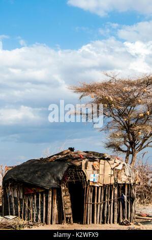 A typical hut or manyatta built with cow dung and clay by the Samburu Maasai in a Samburu village in Northern Kenya, East Africa, Samburu hut, . - Stock Image