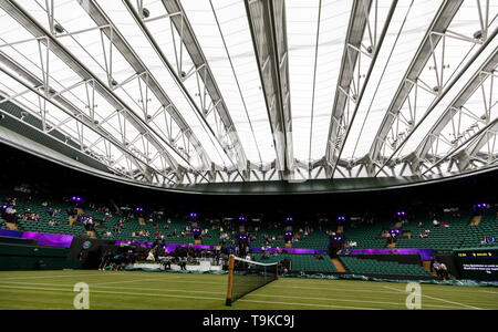 General view of the roof closed due to light rain ahead of the No.1 Court celebration at The All England Lawn Tennis Club, London. - Stock Image