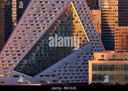 The luxury apartment complex Via West 57 with its unique design at sunset. Midtown West, Manhattan, New York City, USA - Stock Image