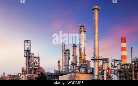 Oil refinery at sunset - Stock Image