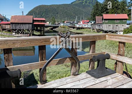 Old wooden stilt homes on Hammer Slough in Petersburg, Mitkof Island, Alaska. Petersburg settled by Norwegian immigrant Peter Buschmann is known as Little Norway due to the high percentage of people of Scandinavian origin. - Stock Image