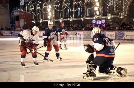 Moscow, Russia. 29th December 2018. Russian President Vladimir Putin #11, left, sets up to take a shot on goal during ice hockey action at the Night Hockey League match in the rink at the GUM Department store in Red Square December 29, 2018 in Moscow, Russia. Credit: Planetpix/Alamy Live News - Stock Image