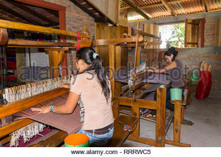 Two weavers on Glimakra floor looms produced yardage for crafts. - Stock Image