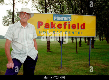 Elderly Man Standing By a Pontin's Holiday Camp Sign, Pakefield, Lowestoft, England - Stock Image