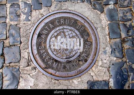 Circular man hole cover in the main town of Santa Cruz, La Palma Island, Canaries, Spain - Stock Image