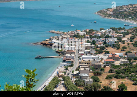 Plaka, Crete, Greece. June 2019. An overview from a mountain of the seaside resort of Plaka. Ferry leave from here to Spinalonga Island. - Stock Image