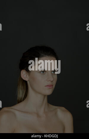 Young woman with bare shoulders, portrait - Stock Image